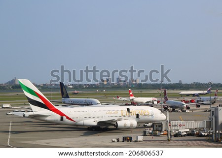 NEW YORK - JULY 22: Emirates Airline Airbus A380 at JFK Airport in New York on July 22, 2014. The Airbus A380 is a double-deck, wide-body, world's largest passenger airliner - stock photo