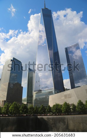 NEW YORK - JULY 17, 2014: Freedom Tower, September 11 Museum and Reflection Pool with Waterfall in September 11 Memorial Park on July 17, 2014  - stock photo