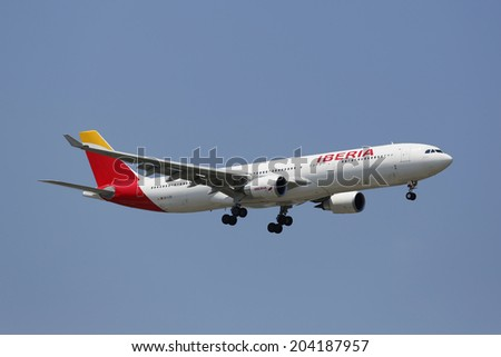 NEW YORK -JULY 10: Iberia Airline Airbus A330 in New York sky before landing at JFK Airport on July 10, 2014  - stock photo