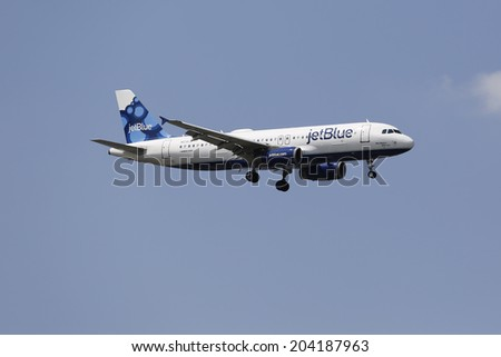 NEW YORK - JULY 10: JetBlue Airbus A320 in New York sky before landing at JFK Airport on July 10, 2014 - stock photo