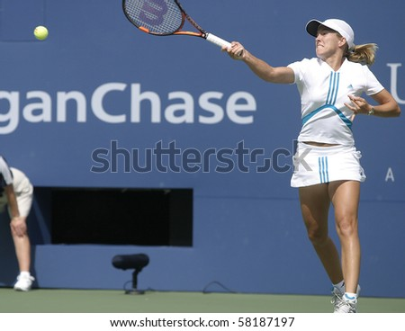 NEW YORK- JULY 19: Justine Henin-Hardenne in action against Nicole Vaidisova July 19, 2004 in Flushing, NY. Henin-Hardenne won the match to advance on in the 2004 US Open. - stock photo