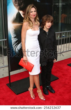 "NEW YORK - JULY 21, 2014: Luciana Gimenez and Lucas Jagger attend the premiere of ""Get On Up"" at the Apollo Theater on July 21, 2014 in New York City. - stock photo"