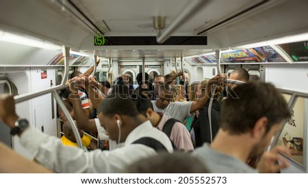 NEW YORK - JULY 14, 2014: passengers on MTA subway train in New York. The NYC Subway is a rapid transit/transportation system in the City of NY. - stock photo