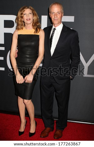 "NEW YORK - July 30, 2012: Rene Russo and Dan Gilroy attend the premiere of ""The Bourne Legacy"" at the Ziegfeld Theater on July 30, 2012 in New York City. - stock photo"
