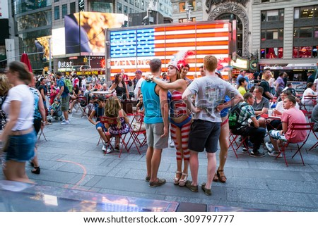 NEW YORK-JULY 22: Topless body painted woman seeking tips in Times Square on July 22 2015 in Manhattan. - stock photo