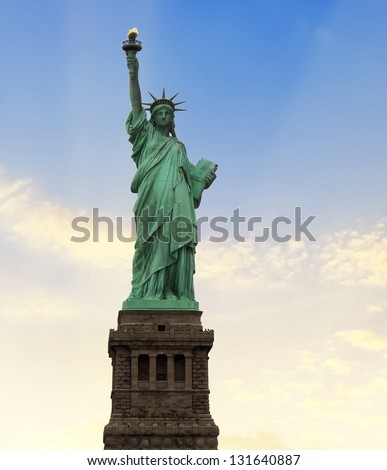 New York, Jun 13: Statue of Liberty at the entrance of the harbor in front of Manhattan. - stock photo