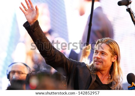 """NEW YORK-JUNE 17: Actor Brad Pitt attends the premiere of """"World War Z"""" at Times Square on June 17, 2013 in New York City.  - stock photo"""