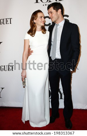 NEW YORK-JUNE 8: Actors Leighton Meester (L) and husband Adam Brody attend American Theatre Wing's 68th Annual Tony Awards at Radio City Music Hall on June 8, 2014 in New York City. - stock photo