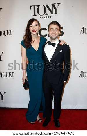 NEW YORK-JUNE 8: Actress Erin Darke (L) and Daniel Radcliffe attend American Theatre Wing's 68th Annual Tony Awards at Radio City Music Hall on June 8, 2014 in New York City. - stock photo