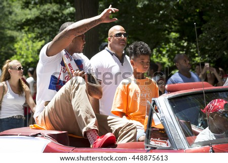 NEW YORK - JUNE 12 2016: Carmelo Anthony, professional basketball player for the New York Knicks rides in a car at the 59th annual National Puerto Rican Day Parade on 5th Avenue in NYC, June 12 2016.  - stock photo