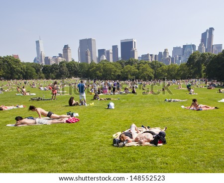 NEW YORK - JUNE 19: Central Park in the summer becomes a very popular place for people to take a break from the busy city on June 19, 2010 in New York, NY, USA. - stock photo