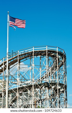 NEW YORK - JUNE 27: Cyclone Roller-coaster on June 27, 2012 in NY. Coney Island is known especially for its amusement park. The attractions reached their peak in the first half of the 20th century. - stock photo