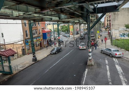 NEW YORK - JUNE 11: elevated subway on June 11, 2014 in New York. The New York City Subway is a rapid transit system owned by the City of New York and leased to the New York City Transit Authority. - stock photo