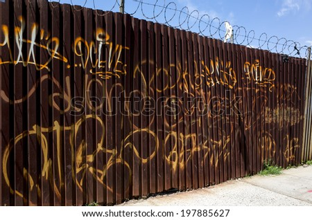 NEW YORK - JUNE 8: Graffiti on June 8, 2014 in New York. Graffiti is writing or drawings that have been scribbled, scratched, or sprayed illicitly on a wall or other surface, often in a public place. - stock photo