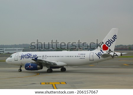 NEW YORK- JUNE 10: JetBlue Airbus A320 with NY's hometown airline tailfin design taxing at John F Kennedy International Airport in New York on June 10, 2014 - stock photo