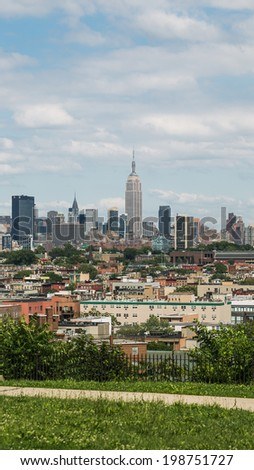 NEW YORK - JUNE 14: Manhattan Skyline on June 14, 2014 in New York. Manhattan is the geographically smallest yet most populous of New York City's five boroughs. - stock photo