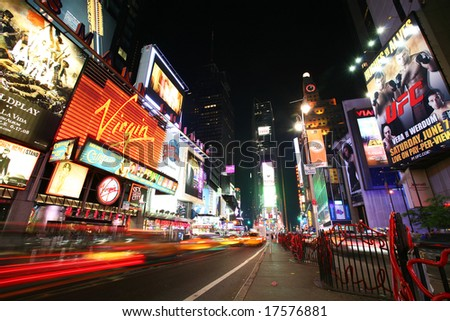 NEW YORK - JUNE 7: New York Times Square traffic at night on June 7, 2008 - stock photo