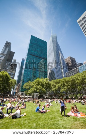 NEW YORK - JUNE 03: People gather in a New York park to enjoy a summer day, in New York, United Stated on June 03, 2011 - stock photo
