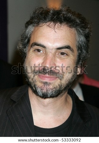 NEW YORK - JUNE 28 : Producer Alfonso Cuaron arrives at New York premier of Palm Pictures' CRONICAS at the Angelika Film Center on Tuesday, June 28, 2005 in New York. - stock photo