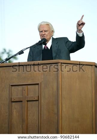 NEW YORK - JUNE 25: Rev. Billy Graham gestures as he preaches at the Greater New York Billy Graham Crusade June 25, 2005 in Flushing, New York. - stock photo