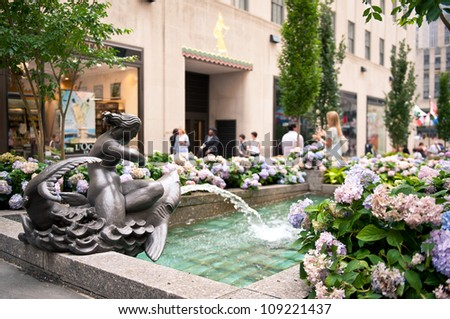 NEW YORK - JUNE 22: Rockefeller Center fountain on Fifth Avenue on June 22, 2012 in New York City. Fifth Avenue has the world's most expensive retail spaces as the symbol of wealthy New York. - stock photo