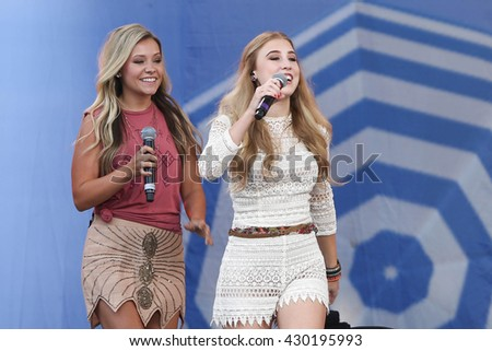 NEW YORK-JUNE 26: Singers Taylor Dye (L) and Madison Marlow of Maddie and Tae perform onstage at ABC's Good Morning America Summer Concert Series at Rumsey Playfield on June 26, 2015 in New York City. - stock photo