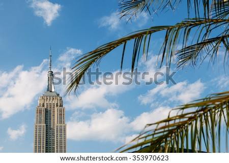 NEW YORK - JUNE 11: The Empire State Building in summer day at New York, one of the most iconic landmarks of the USA on March 11th, 2015 in New York, USA.  - stock photo