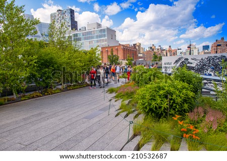NEW YORK - JUNE 15, 2013: The High Line Park in New York with locals and tourists. The High Line is a popular linear park built on the elevated train tracks above Tenth Ave in New York City - stock photo