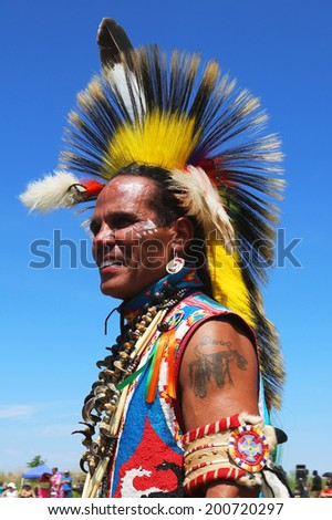 NEW YORK - JUNE 8: Unidentified Native American dancer at the NYC Pow Wow in Brooklyn on June 8, 2014. A pow-wow is a gathering and Heritage Celebration of North America s Native people  - stock photo