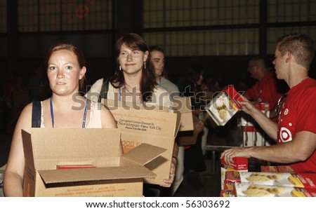 NEW YORK - JUNE 29: Unidentified volunteers help assemble meals at 'Target Party for Good' South Street on June 29, 2010 in New York City. - stock photo