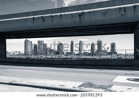 New York - JUNE 21: View of buildings framed by de FDR Drive in New York, USA on June 21, 2014 - stock photo