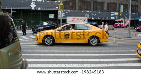 NEW YORK - JUNE 6: Yellow Cab on June 6, 2014 in New York. Canary yellow in color, medallion taxis are able to pick up passengers anywhere in the five boroughs. - stock photo
