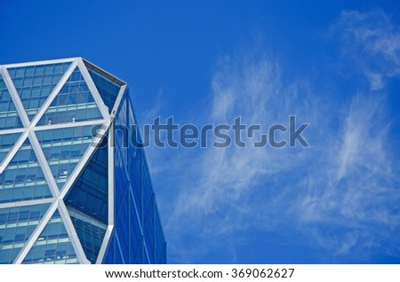 New York: looking up at the Hearst Tower on September 14, 2014. The Hearst Tower is the world headquarters of the Hearst Corporation, its construction was completed in 2006 - stock photo