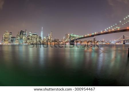 new york manhattan night view from brooklyn - stock photo