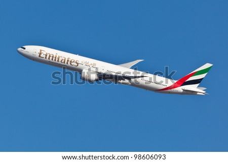 NEW YORK - MARCH 10: Boeing 777 Emirates climbs after take off from JFK airport located in New York March 10, 2012 Emirates is rated as a top10 best airline in the world flying on youngest fleet - stock photo