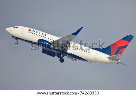 NEW YORK - MARCH 2: Boeing 737-600 of Delta climbs after take off from JFK airport located in New York, USA on March 2, 2011. Boeing 737-600 is one of the oldest models of B737 still used by airlines - stock photo