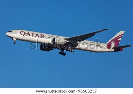 NEW YORK - MARCH 5:Boeing 777 Qatar on final approach to JFK in New York, USA on March 5, 2012 Qatar Airline is rated 3rd best airlines in the world Qatar airline is flag carrier airline of Qatar - stock photo