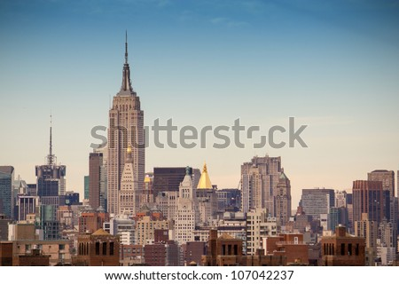 NEW YORK - MARCH 6 : Empire state building facade shines at sunset. It stood as the world's tallest building for more than 40 years (from 1931 to 1972), March 6th, 2011 in New York City, USA - stock photo