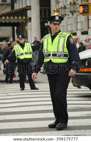 NEW YORK - MARCH 17, 2016: NYPD Officers providing security during St. Patrick's Day Parade in Midtown Manhattan - stock photo