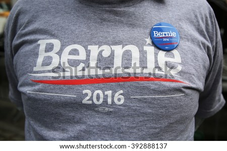 NEW YORK - MARCH 17, 2016: Presidential candidate Bernie Sanders supporter wears t-shirt and button with sign Bernie 2016. The US presidential election of 2016, scheduled for Tuesday, November 8, 2016 - stock photo