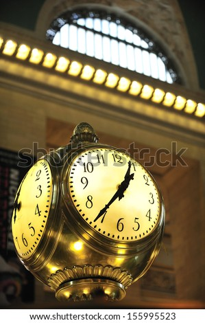 NEW YORK, March, 21st, 2013. Clock over the information booth in the middle of the great hall in Grand Central Terminal - New York on March, 21st.  - stock photo