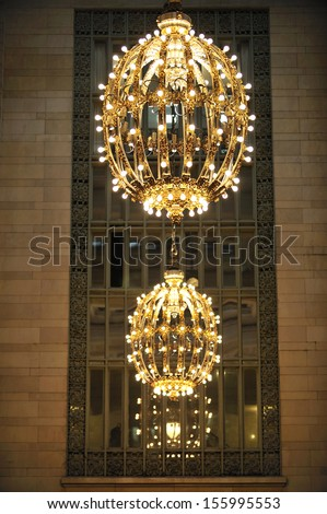 NEW YORK - March, 21st: Grand Central Station lamps on the ceiling of Vanderbilt hall on March, 21st, 2013, in New York City. - stock photo