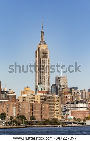 NEW YORK - MARCH 15: The Empire State Building shines in the afternoon on March 15th, 2010 in New York, USA. The Empire State Building is a 102-story landmark and American cultural icon in New York. - stock photo