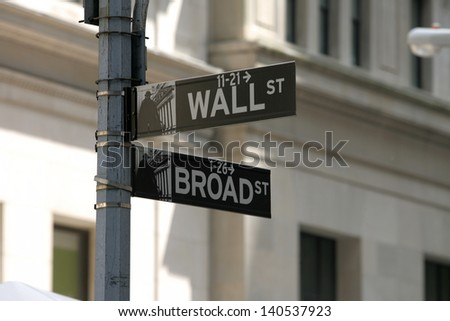 NEW YORK - MAY 30: A Wall Street street sign is shown on May 30, 2013 in New York City. - stock photo