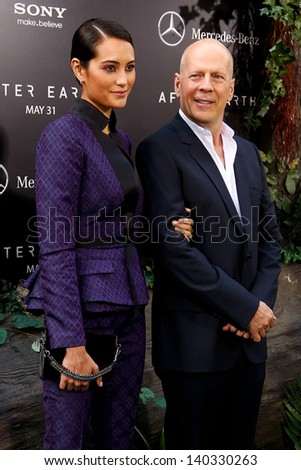 """NEW YORK - MAY 29: Actor Bruce Willis and wife Emma Heming attend the premiere of """"After Earth"""" at the Ziegfeld Theatre on May 29, 2013 in New York City.  - stock photo"""