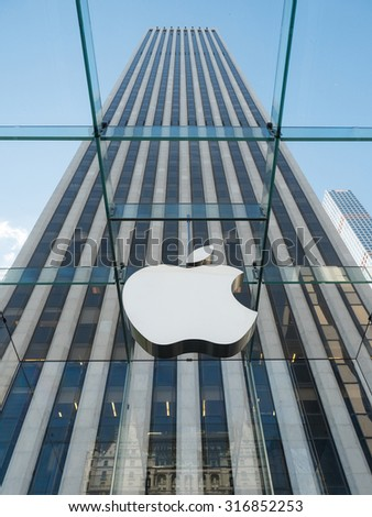 NEW YORK - MAY 13, 2015: Apple logo at the entrance of 5th Avenue store in Manhattan. As of 2014, Apple employs 72,800 permanent full-time employees, maintains 437 retail stores in fifteen countries.  - stock photo
