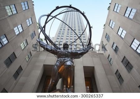 NEW YORK - May 29, 2015: Atlas Statue at Rockefeller Center on May 29, 2015. The Atlas Statue is a bronze statue in front of Rockefeller Center in midtown Manhattan, New York City. - stock photo