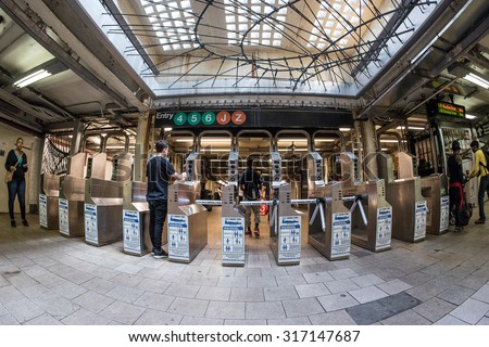 NEW YORK - MAY 10, 2015: Entrance of subway station. The NYC Subway is one of the oldest and most extensive public transportation systems in the world, with 468 stations. - stock photo