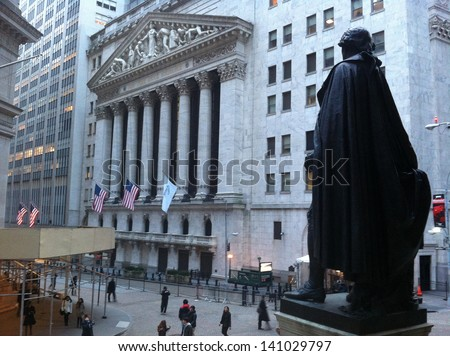 NEW YORK - MAY 13: From Federal Hall, pedestrians walk along Broad Street past the New York Stock Exchange on May 13, 2013 in New York City. The Exchange building was built in 1903. - stock photo