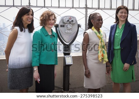 NEW YORK - MAY 5, 2015: Jill Scalamandre of Coty Skincare, Mary Giliberti of NAMI, NY First Lady Chirlane McCray, and Barbara Ricci of NAMI on the observatory deck of the Empire State Building. - stock photo